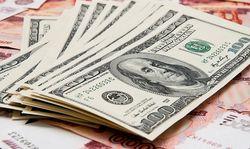 На открытии торгов курс доллара снизился до 62,56 рубля